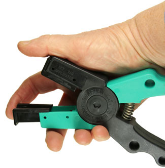 Image of SET tag applicator: inserts sliding into place